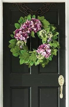 With deep purple figs and hydrangea petals, vibrant berries and a rich backdrop of lemon leaves, the Palma Lemon Leaf Hydrangea Wreath is an accent for all seasons. The faux foliage is crafted from polyester, plastic and wire for lasting durability and superior realism.