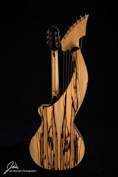 Awesome striped Ebony Harp Guitar by luthier Kathy Wingert from Los Angelos, California, USA