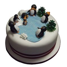 <b>Penguin Xmas Cake</b><br />Delicious boozy fruit Xmas cake decorated with penguins having fun in the snow!