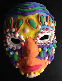 Another Model Magic Mask. Use a paper mache mask base so things stick together.