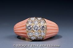 Cartier - An unusual fluted coral and diamond dome ring,
