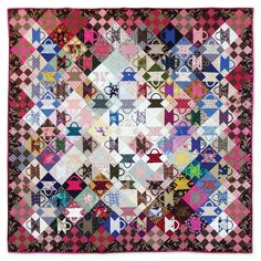 "Postage Stamp basket quilt, 58 x 58"", by Alex Anderson.  Cover of the book 'Quilts for Fabric Lovers'"