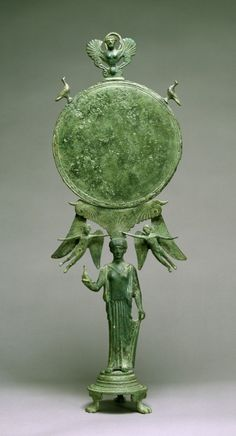 """ancientpeoples: """" Caryatid Mirror with Aphrodite Greece, ca. 460 BC (Classical) Bronze """"A graceful female figure serves as a """"caryatid,"""" or human support, for a mirror. The figure's pose, demure. Ancient Greek Art, Ancient Rome, Ancient Greece, Ancient History, Aphrodite, Greek Artifacts, Ancient Artifacts, Mythical Birds, Classical Greece"""