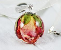 Pendant real rose bud casted in clear resin ball by RESILIN