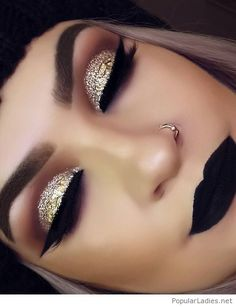 Gold glitter eye makeup with black lips