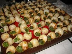 Escargot is a dish of cooked land snails served as an appetizer in France and in French restaurants.