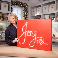 Watch Martha demonstrate how to make an eye-catching lighted holiday sign that will look beautiful indoors or out.