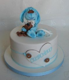 Cake for christening by lamps