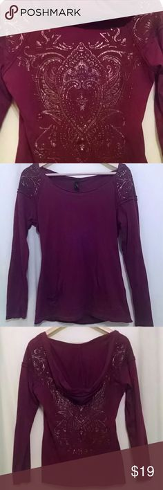 🆕Cute Design Seven 7 Long Sleeve Hooded Top Tee ❤Seven 7 Long Sleeve Hooded Tee Shirt Top in Deep Burgundy❤ 👉NEW LISTING Cool silver & gold metallic embellished design on back & across front & back shoulders with raw rolled edges along seams. Scooped neckline with lower front opening with open sides for your hands with logo at edge.  Gently worn in excellent like new condition!  Size Small in super soft cotton/poly blend Seven 7 Tops Tees - Long Sleeve