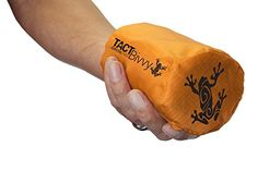 TACT Bivvy Emergency Sleeping Bag by Survival Frog - CONVENIENT TO STORE: When inside the stuff sack this bivvy bag is so small it fits in the palm of your hand - which means you can store it anywhere. We recommend keeping it in your bug out bag, camping gear, and/or glove box so you have it ready when you need it.. EASY TO USE: Just unpack the sleeping bag from the included stuff sack and slide inside - or use it as a sleeping bag liner and raise your body temperature by 20°!. INCREDIBLY…