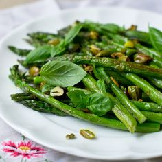 You can taste springtime with this recipe for Roasted Asparagus with Basil and Pistachios. Its ingredients are fresh and light.