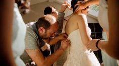 Syrian refugee Ibrahim Halil Dudu fixes the broken zip on Jo Du's wedding dress