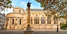 The Temple Church is a late 12th-century church in the City of London located between Fleet Street and the River Thames, built by the Knights Templar as their English headquarters. During the reign of King John (1199-1216) it served as the royal treasury, supported by the Knights Templars as proto-international bankers. It is famous for being a round church, a common design feature for Knights Templar churches, and for its 13th and 14th century stone effigies.