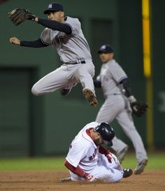 DJ leaping over Johnny Gomes