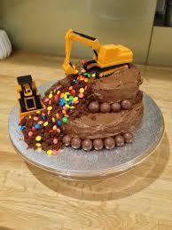 A birthday cake with active construction excavate a small hunk out