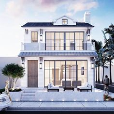 Render of the week | A sleek patio clapboard siding and all the windows you could ask for on this inviting beach home!