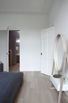 Interesting idea - floor length mirror perhaps with small cabinet table