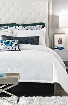 pretty pops of color on a white duvet. loving this modern look!
