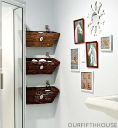 bathroom storage: hang window baskets on an odd bathroom wall eliminates wasted space & adds great storage space.