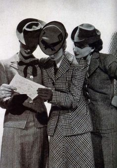 Wonderful example of the menswear suits and matching hats that were so popular. In fact, my aunt took one of her husband's suits & made my Mom a very nice striped worsted wool suit...she was a marvelous seamstress!