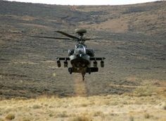 """An Apache rises from behind a hill during a training exercise at Yakima Training Center. The Guardian replaces the """"Longbow"""" and integrates more powerful engines, improved rotor blade technology and advanced electronics. Attack Helicopter, Military Helicopter, Military Aircraft, Ah 64 Apache, Fort Campbell, Longbow, Military Weapons, Military News, National Guard"""