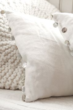 Cushions with mother of pearl buttons | Tine K Home