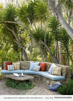 Outdoor stone seating area by Grace Design Associates, Inc.