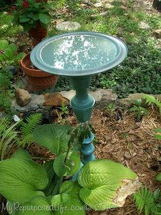from MyRepurposedLife-how to make a birdbath from a giant candlestick and a pot lid.