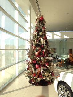 Car dealership decorated for the holidays by Flowers & Home!