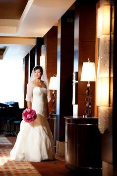 A beautiful bride stuns on her wedding day at The Ritz-Carlton, Denver, Colorado.