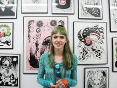 claire boucher  she looks amazing she draws she makes music and she look like an elf..