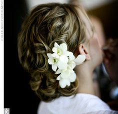 Possibly my wedding hair ??  Less the flowers - add an antique brooch and bird cage netting.