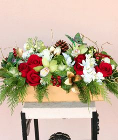 A Spectacular Table Centerpiece Of Gorgeous Blooms Tastefully Arranged And Complimented With All The