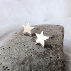 Silver Star Stud Earrings are a sweet way to spice up your wardrobe. The little stars were hand sawn from a thick sheet of sterling silver. The earrings are tumbled and then given a satin brushed fini