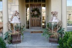 More decorating with lanterns.  I love the simplicity of just a little greenery, pinecones and ribbon.  Looks fab!