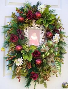 A Lovely Elegant floral holiday wreath!!! Bebe'!!! Love the Framed Baby Picture in the center of the wreath!!!.