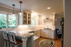 Beautiful-hinkley-lighting-in-Kitchen-Transitional-with-Porcelain-Tile-Looks-Like-Marble-next-to-Most-Popular-Granite-Colors-alongside-White-Subway-Tile-Grey-Grout-andWhite-Kitchen-. Decor, Transitional Kitchen, Grey Kitchen Inspiration, Kitchen Remodel, Kitchen Decor, Bungalow Decor, Kitchen Redo, Kitchen Dining, Home Kitchens