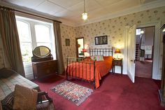 The Green Room - a double en suite bedroom with brass bed at Glencarron Lodge http://www.glencarronestate.co.uk