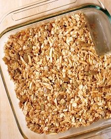 """Simple pantry ingredients come together in a healthful afternoon snack that will tide everyone over until dinnertime.  """"My kids and I love making granola bars together. These  power-packed treats are easy to prepare, fun to eat, and full of protein and whole grains for keeping the family healthy and strong. Unlike a store-bought granola bar, my homemade version has no added preservatives. Feel free to substitute your favorite nuts and dried fruits to suit your family's taste buds."""""""