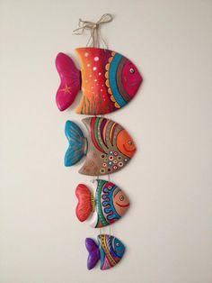 Deze vissenhanger brengt wat kleur in een 'water'-kinderkamer.