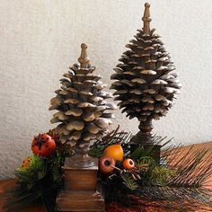An unusual pine cone form finial. At 13 inches tall it adds drama to a table setting for fall or Christmas decorating.