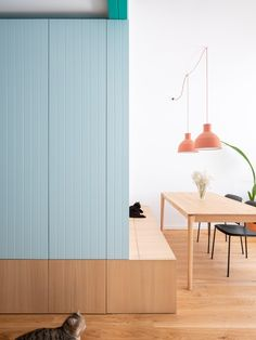 Pastel color built in furnitures blur the limits of different rooms, creating a fluid open space.  Built In Furniture, Space Saving Furniture, Room Interior, Interior Design, Half Walls, Multifunctional Furniture, Terrazzo Flooring, Built In Bench, Built In Wardrobe