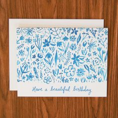 Send birthday wishes to any flower lover with this birthday card featuring hand-painted blue flowers. Available as a single card paired with a 100% recycled white envelope and packaged in a clear slee