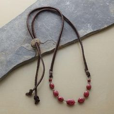 LEATHER RUBY NECKLACE: Crimson rubies, set asparkle by expert faceting, offer rich contrast to supple strands of leather. Necklace adjusts to Red Jewelry, Bohemian Jewelry, Jewelery, Vintage Jewelry, Jewelry Necklaces, Fashion Jewelry, Antique Jewelry, Ruby Necklace, Beaded Necklace