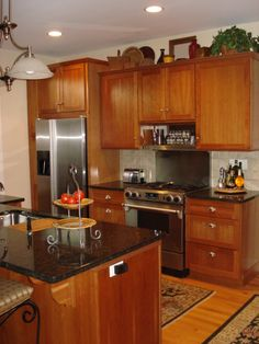 honey oak kitchen cabinets with black countertops | Everyone Ends Up in the Kitchen - Kitchen Designs - Decorating Ideas ...