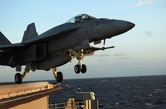 """An F/A-18E Super Hornet from the """"Pukin' Dogs"""" of Strike Fighter Squadron (VFA) 143 launches from the angle deck of the Nimitz-class aircraft carrier USS DWIGHT D. EISENHOWER (CVN 69). USN photo."""