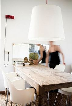 Old farmhouse table and modern white chairs. Love.