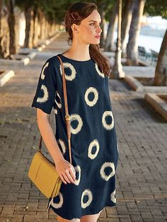 Our Circle Ikat dress is cut from a structured textured fabric for a flattering silhouette. This t-shirt style dress falls at the knee and comes fully lined. Featuring a bold graphic print it's finished with casual turned-up cuffs. Fall Dresses, Cotton Dresses, Long Midi Dress, Teacher Outfits, Teacher Clothes, Pretty Outfits, Pretty Clothes, Fashion Books, Ikat