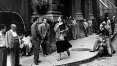 Jinx Allen, as she was then called, was captured walking through Florence's Piazza della Repubblica and drawing the admiring gaze of crowds of men by the American photographer Ruth Orkin in 1951