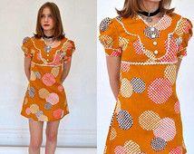 Vintage 60's mod mini dress/sz xs - s/ 1960's empire waist, puff sleeve Dolly Rocker retro mustard abstract polkadot cotton ric rac bib trim